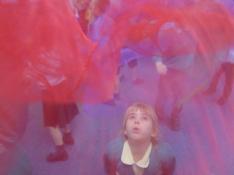 Blowing-juggling-scarves-at-TK-Arts-circus-day-in-primary-school-web