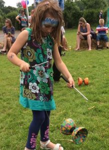 Child-learns-diabolo-at-school-fete-with-TK-Arts-circus-workshop