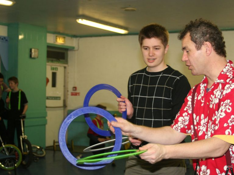 Circus-workshop-at-youth-club-for-SEND-ring-juggling-with-TK-Arts-web