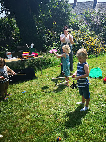 Learning-the-flower-stick-at-TK-Arts-circus-party-for-children