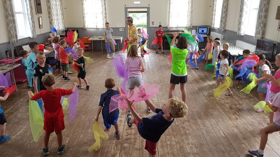 TK Arts circus workshop at playscheme for children scarf juggling