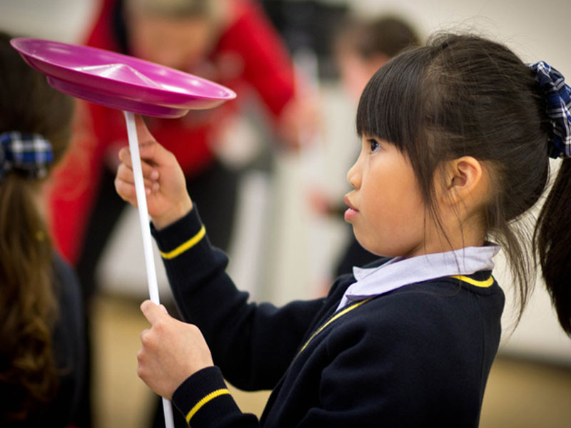 TK-Arts-circus-workshop-at-primary-school-balancing-a-spinning-plate-on-finger-web
