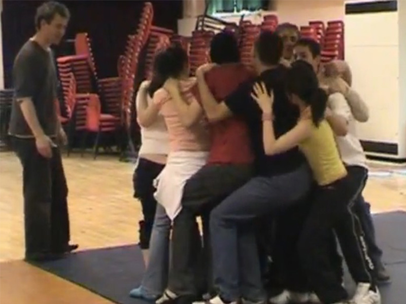 TK-Arts-youth-drama-workshop-trust-game-sitting-on-knees-in-circle-web