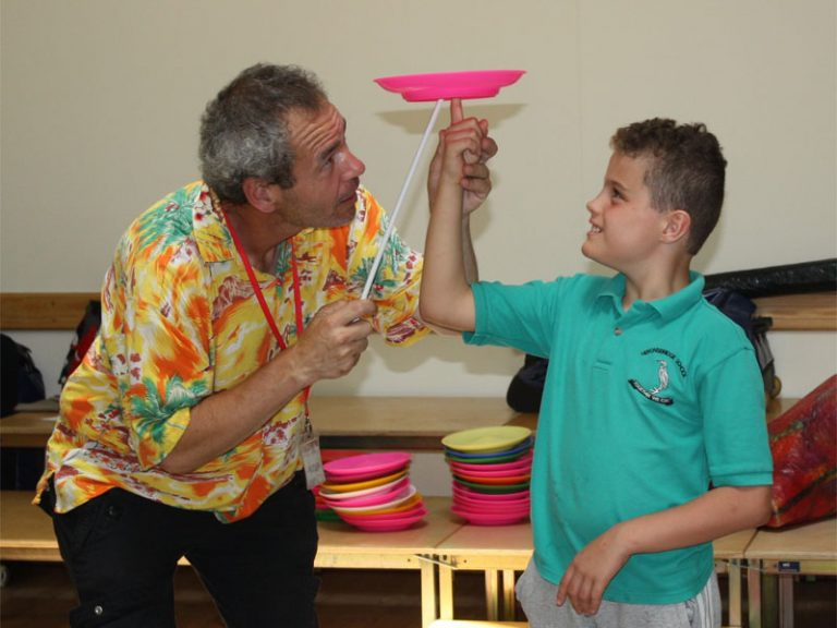 Tom-TK-Arts-teaches-child-how-to-spin-a-plate-on-his-finger-SEND-circus-workshop