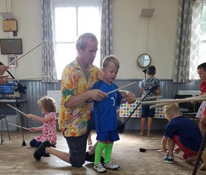 Understanding-how-the-flower-stick-works-with-Tom-at-TK-Arts-circus-workshop-with-children-at-playscheme