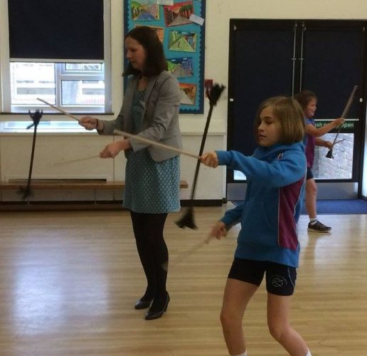 Learning the flower stick at primary school circus day with TK Arts