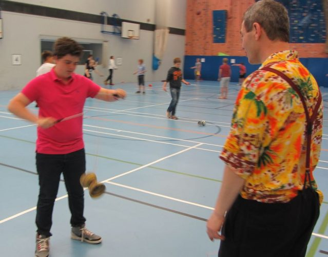 Tom TK Arts teaches diabolo trick at secondary school circus day